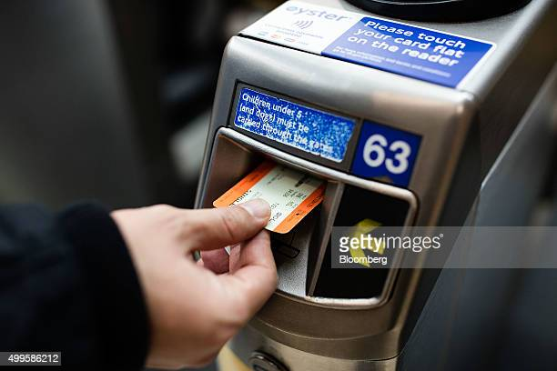 A commuter puts his paper ticket through the reader on the ticket barrier at London Marylebone railway station operated by The Chiltern Railway...