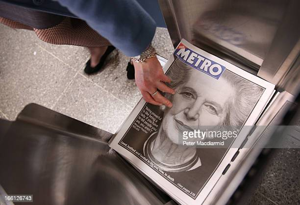 A commuter reaches for a copy of a free newspaper at Waterloo station the day after the death of former Prime Minister Lady Thatcher on April 9 2013...