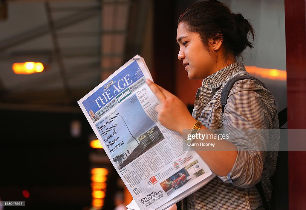 A commuter reads The Age's first compact edition newspaper at Flinders Street Station on March 4, 2013 in Melbourne, Australia. The Sydney Morning Herald and The Melbourne Age published their first tabloid size editions today, after 180 years of producing weekday broadsheets.