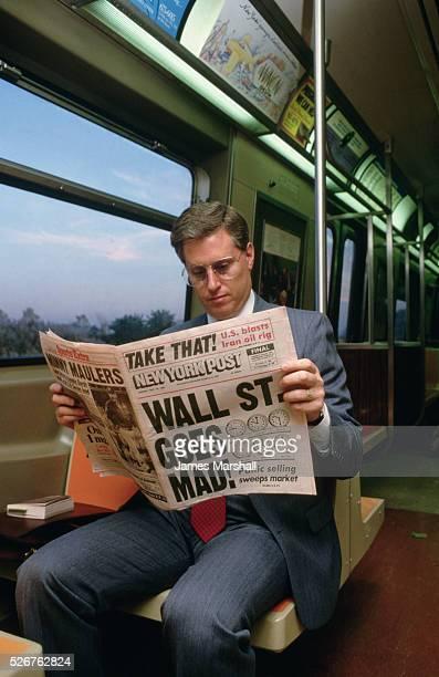 A commuter reads the New York Post's rundown of Wall Street's 1987 stock market crash