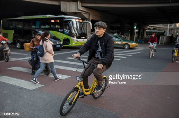 A commuter rides a bike share during rush hour on March 27 2017 in Beijing China The popularity of bike shares has exploded in the past year with...