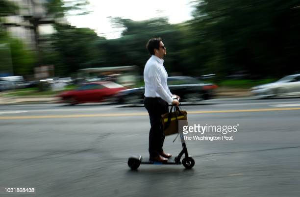 A commuter rides a scooter on 15th Street NW Washington DC Friday August 31 2018