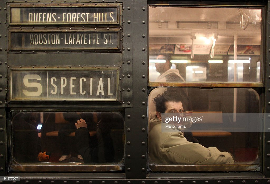 A commuter rides an antique subway train during a 'Vintage Tea Party' hosted by Levy's Unique New York tour group December 13, 2009 in New York City. New York City Transit is running a special 1930's era subway train every Sunday this month from Manhattan to Queens complete with ceiling fans and wicker seats.