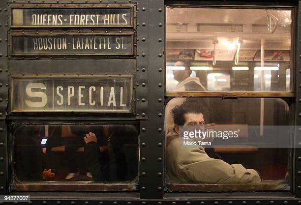 A commuter rides an antique subway train during a 'Vintage Tea Party' hosted by Levy's Unique New York tour group December 13 2009 in New York City...