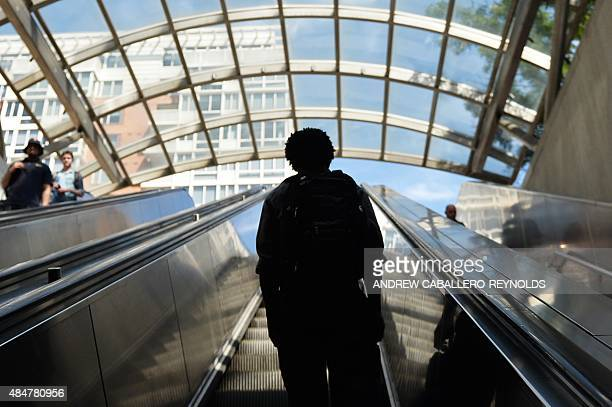 A commuter rides an elevator out of the metro in Washington DC on August 21 2015 New claims for US unemployment insurance benefits rose modestly last...