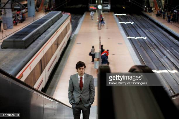A commuter rides an escalator at Atocha railway station during the 10th anniversary of Madrid train bombings on March 11 2014 in Madrid Spain Spain's...