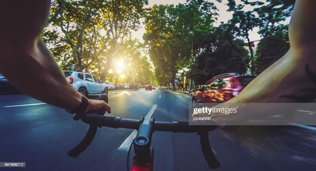 POV commuter riding a road racing bicycle in the city : Stock Photo