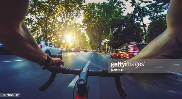 pov commuter riding a road racing bicycle in the city - handlebar stock photos and pictures