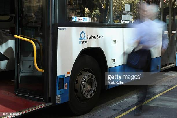 A commuter runs to catch a bus on York street in the CBD on February 19 2013 in Sydney Australia State Transit will be cutting buses on dead routes...