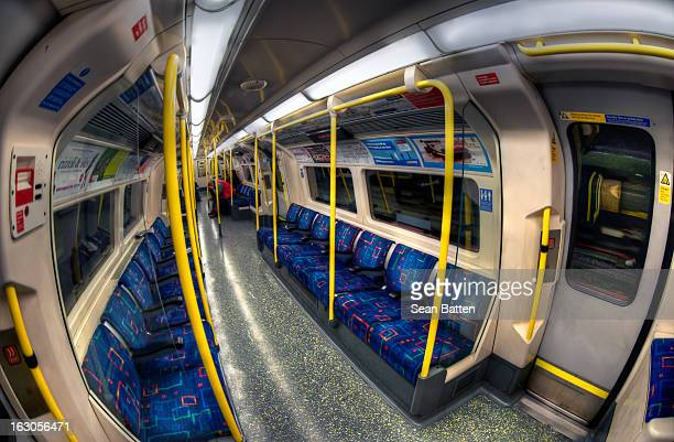 CONTENT] A commuter sat on a London Underground train with his head in his hands