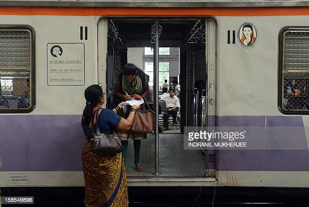 A commuter signs a petition condemning the gangrape of a 23old student in New Delhi at a suburban railway station in Mumbai on December 19 2012...