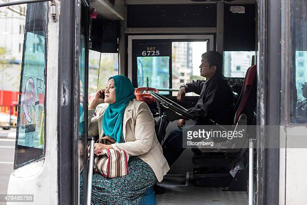 Commuter sits in a bus operated by Metrobus Nationwide Sdn. Bhd. While waiting for the bus to depart in Kuala Lumpur, Malaysia, on Tuesday, March 18,...