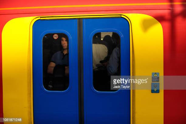 A commuter stands on a train as it passes through Clapham Junction Station during the morning rush hour on October 11 2018 in London England The...