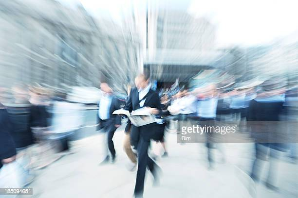 commuter traffic, businessman walking, reading newspaper, motion blur, london, england - publication stock pictures, royalty-free photos & images