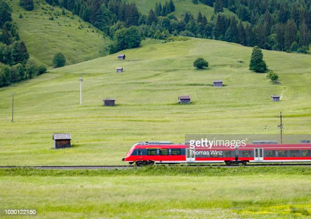 commuter train in a agricultural landscape - austria stock pictures, royalty-free photos & images