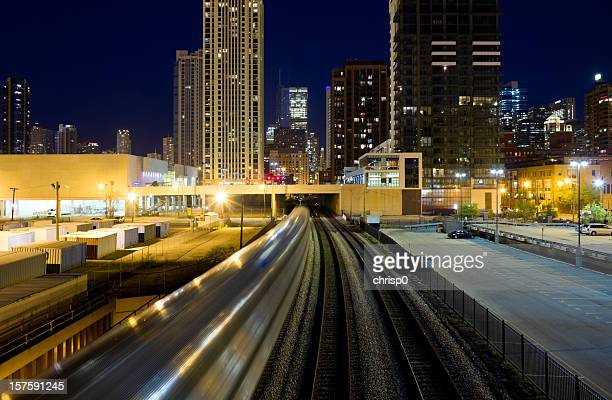 commuter train in downtown chicago - metra train stock photos and pictures