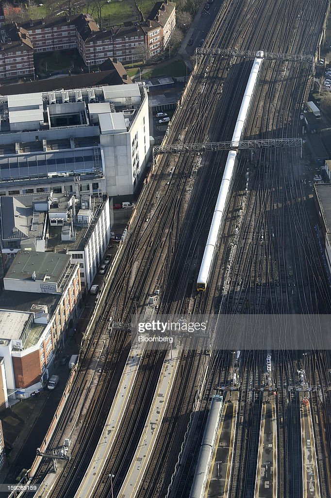 A commuter train is seen arriving at London Bridge mainline rail station from 'The View From The Shard', a series of viewing galleries near the top of the Shard tower in London, U.K., on Wednesday, Jan. 9, 2013. The Shard, which stands at 309.6 meters on London's South Bank, is owned by LBQ Ltd., which brings together the State of Qatar (the majority shareholder) and Sellar Property Group Ltd., with non-equity funding by Qatar National Bank. Photographer: Chris Ratcliffe/Bloomberg via Getty Images