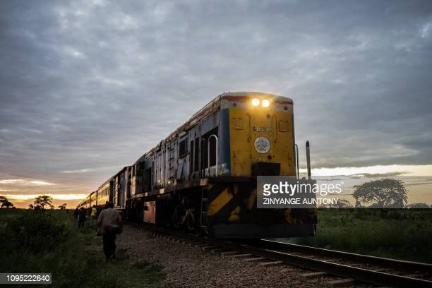 Commuter train known as the 'Freedom Train' approaches a station early morning on January 29, 2019 in Cowdray Park township, in Bulawayo, Zimbabwe. -...
