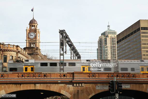 A commuter train operated by Sydney Trains arrives at Central Station in Sydney Australia on Tuesday June 9 2015 Australian wages fell in the first...