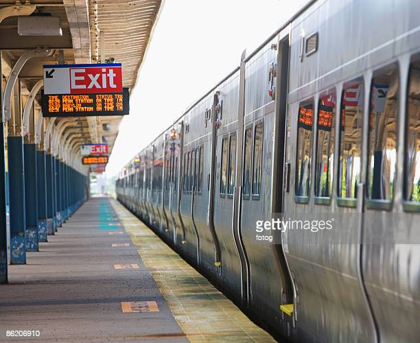 commuter train parked at station platform - long island stock pictures, royalty-free photos & images