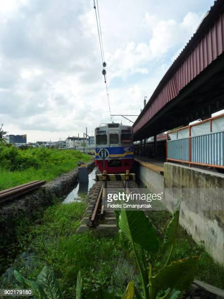 A commuter train stops at Kampung Bandan train station in Jakarta, Indonesia