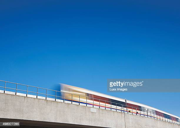 Commuter train travelling across bridge