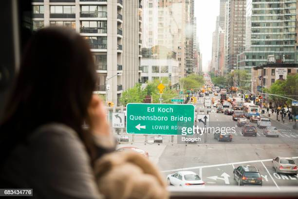 Commuter Tram Passenger Looks at Street View NYC  USA