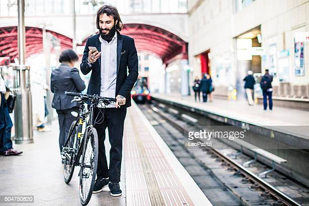 Commuter waiting the train with his bicycle