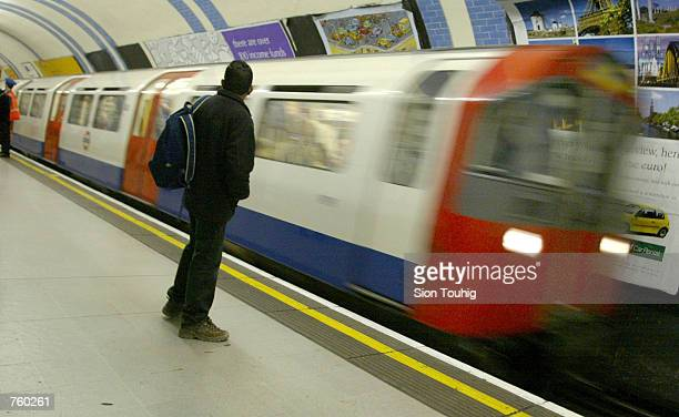 A commuter waits for an incoming London Underground train March 29 2002 at Green Park Underground station in London Confidential documents have...