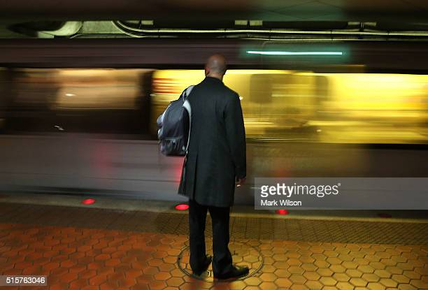Commuter waits to board a Metrorail train at Union Station, March 15, 2016 in Washington, DC. Metrorail announced today that they will shut down...