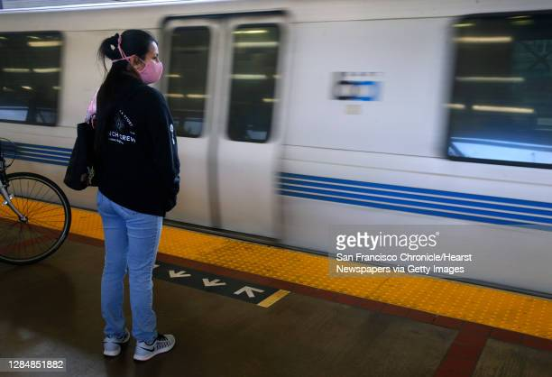 Commuter waits to board a train arriving at the MacArthur BART station in Oakland, Calif. On Tuesday, May 12, 2020. BART is joining transit agencies...