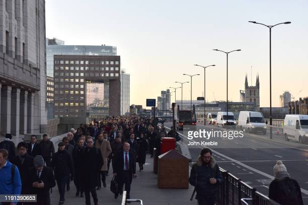 Commuter walk across London Bridge early morning as the bridge is reopend after the recent stabbing attack on December 02 2019 in London England A...