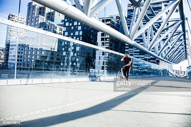 Commuter walking on a bridge in the morning