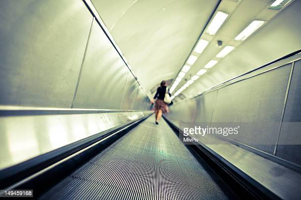 Commuter walking through tunnel at Bank Tube Station