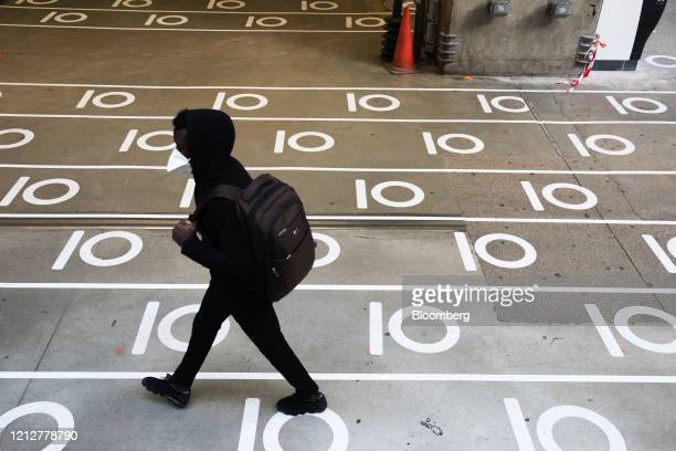 A commuter walks across social distancing floor markers at Gare Montparnasse railway station in Paris France on Tuesday May 12 2020 The Paris metro...