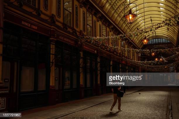 Commuter walks past closed shops at Leadenhall Market in the City of London, U.K., on Monday, July 20, 2020. U.K. Prime Minister Boris Johnson nudged...
