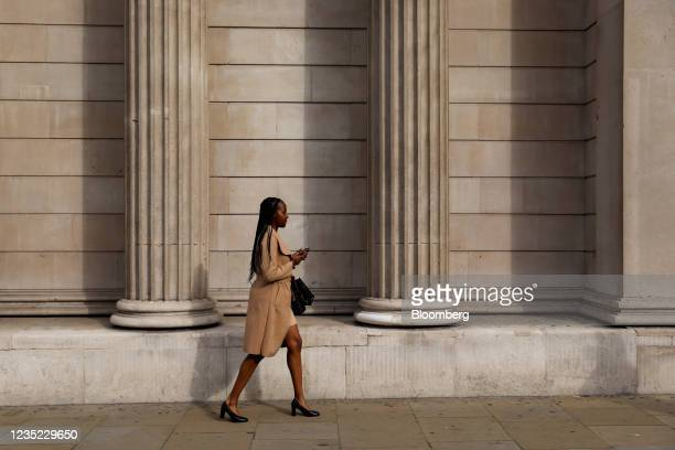 Commuter walks past the Bank of England in London, U.K., on Monday, Sept. 13, 2021. The ending of the government's furlough scheme in September will...