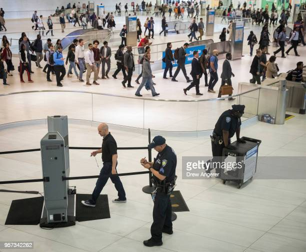 Commuter walks through at a new security screening system being tested at the World Trade Center Transportation Hub PATH Train station, May 11, 2018...