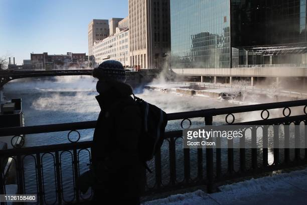 A commuter walks through downtown in subzero temperatures during an extremely light morning rush hour on January 30 2019 in Chicago Illinois...