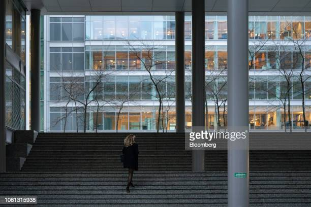 A commuter walks towards office buildings in the Zuidas financial district in Amsterdam Netherlands on Friday Jan 11 2019 A large part of the latest...