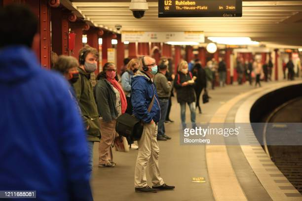 A commuter wearing protective face masks wait on a platform at Alexanderplatz UBahn train station in Berlin Germany on Monday May 4 2020 Germany...