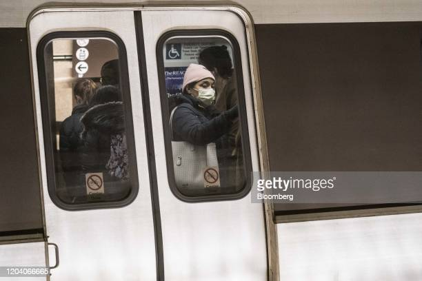 A commuter wears a face mask in the Metro Center train station in Washington DC US on Friday Feb 28 2020 New reports have shown cases of coronavirus...