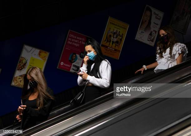 Commuter wears a protective face mask at Stratford station in London, England on June 15th 2020. The Government enforced a new law which makes it...