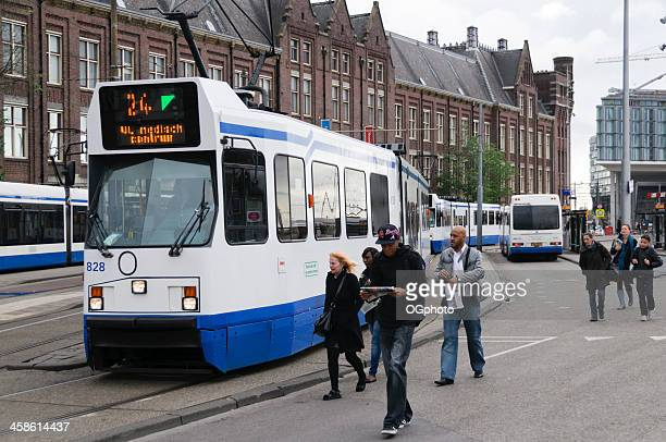 commuters about to catch tram - ogphoto stock pictures, royalty-free photos & images