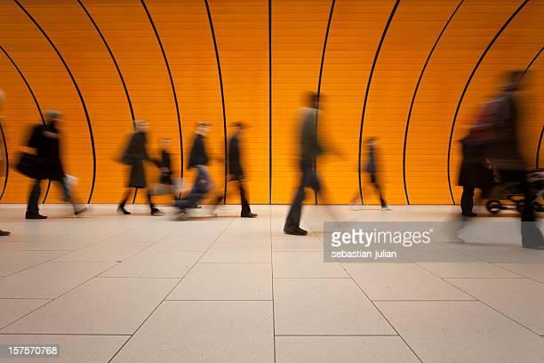 commuters against modern orange background