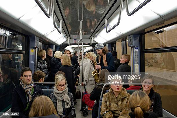 Commuters and busker on Paris Metro.