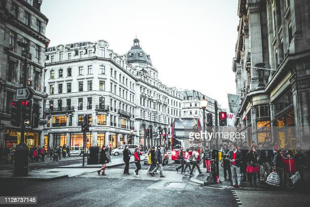 Commuters and tourists are walking on Oxford street, London