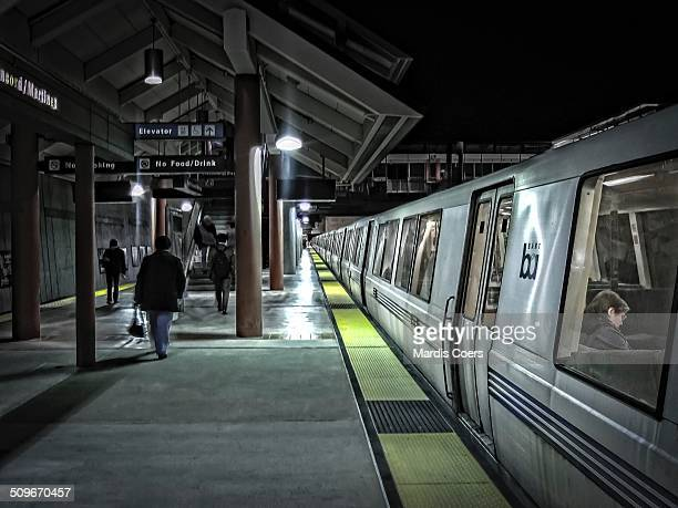 Commuters and train riders at the Concord/Martinez BART station at nighttime