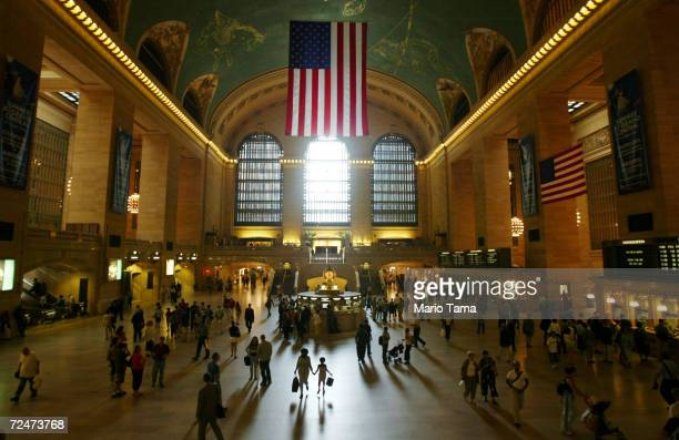 Commuters and travellers pass through Grand Central Station July 1, 2004 in New York City. AAA estimates that 39.4 millions Americans will travel 50...