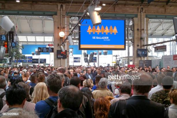commuters and travellers stuck in gare du nord - striker stock pictures, royalty-free photos & images